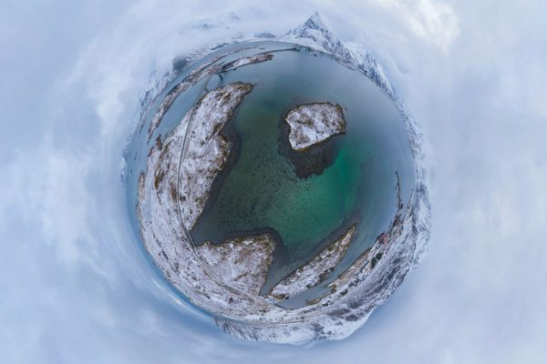 Little planet 360 degree sphere. Panorama of aerial view of white snow mountain in Lofoten islands, Nordland county, Norway, Europe. Nature landscape in winter. Nature landscape background.
